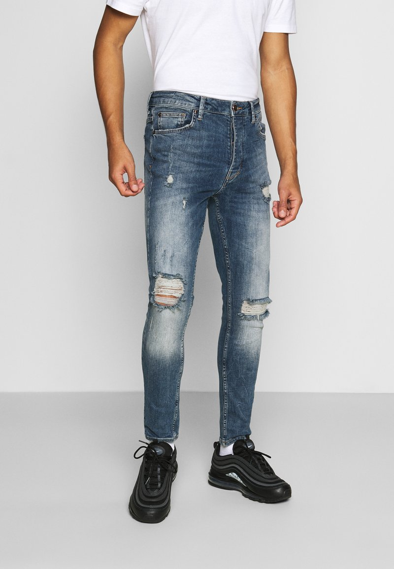 Gym King - FORD RIP AND REPAIR SKINNY JEANS - Jeans Skinny Fit - mid blue