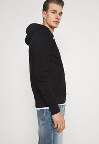 Tommy Hilfiger - CIRCLE CHEST HOODY - Felpa con cappuccio - black - 3