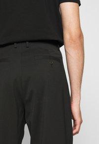 Just Cavalli - PANTALONE - Trousers - black - 5