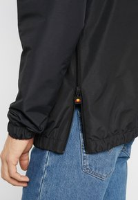Ellesse - MONT REFLECTIVE - Summer jacket - black - 6