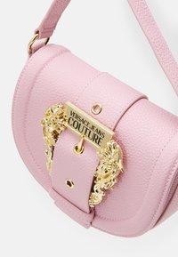 Versace Jeans Couture - CROSSBODY - Handbag - pink - 4