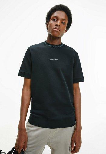 T-shirt con stampa - ck black