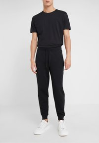 HUGO - DOAK - Tracksuit bottoms - black - 0