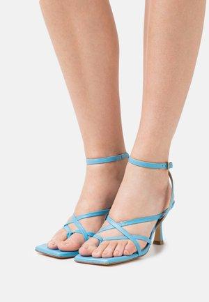 Teensandalen - clear blue