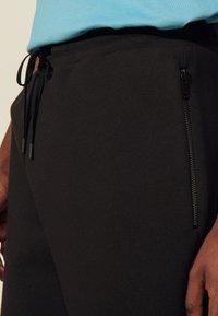 sandro - Tracksuit bottoms - noir - 4