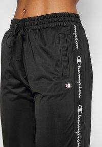 Champion - ELASTIC CUFF PANTS - Tracksuit bottoms - black - 3