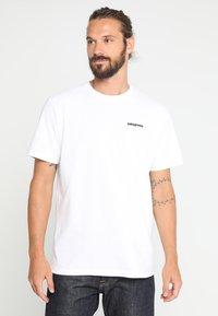 Patagonia - LOGO RESPONSIBILI TEE - Print T-shirt - white - 0