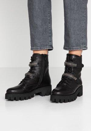 ANSTER - Cowboy/biker ankle boot - black