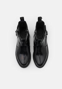 Dr. Martens - FLORA  - Kotníkové boty - black - 5