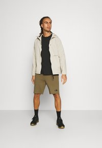 The North Face - MENS GRAPHIC SHORT  - Träningsshorts - military olive - 1