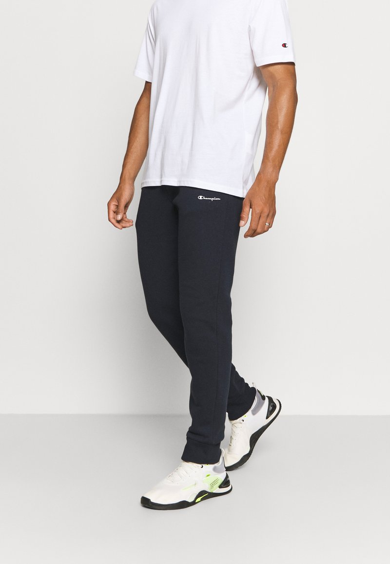 Champion - CUFF PANTS - Tracksuit bottoms - dark blue
