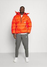 Carhartt WIP - JONES  - Zimní bunda - safety orange - 1
