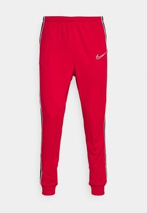 ACADEMY PANT - Teplákové kalhoty - gym red/black/white