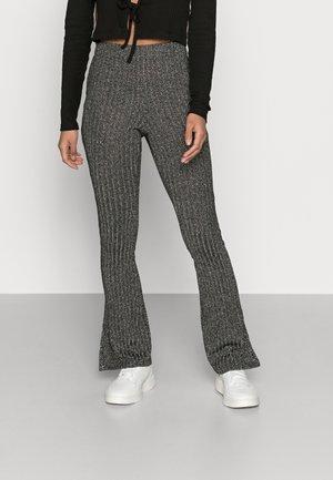 GLITTER FLARE - Pantalones - black