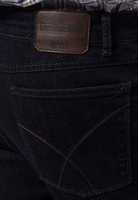 BRAX - STYLE COOPER  - Straight leg jeans - dark blue - 4