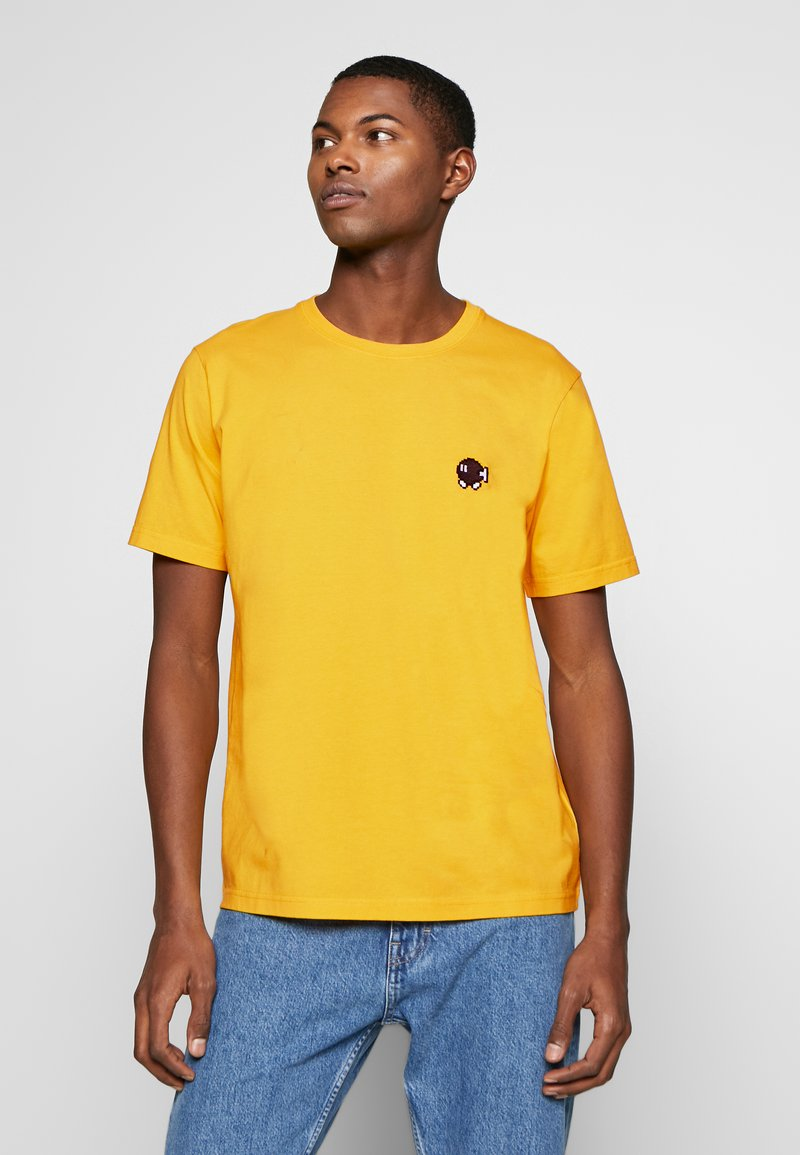 Bricktown - BOMB SMALL - Print T-shirt - yellow