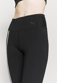 Puma - TRAIN - Leggings - black/white - 5