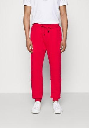 PANTALONE - Tracksuit bottoms - red