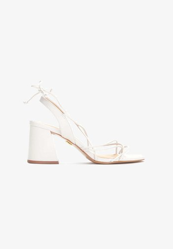 CLAUDIA - T-bar sandals - white