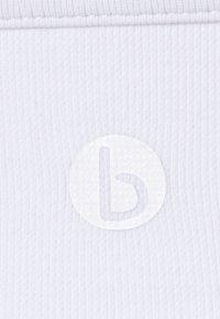 Cotton On Body - LIFESTYLE SEAMLESS V NECK  - Light support sports bra - white - 2