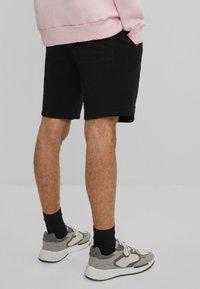 Bershka - 2 PACK - Shorts - black - 2