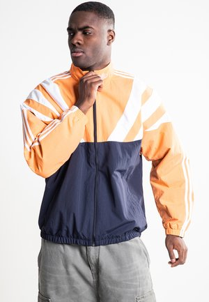 Training jacket - legend ink/easy orange