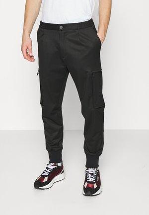 GLAVIN - Trousers - black