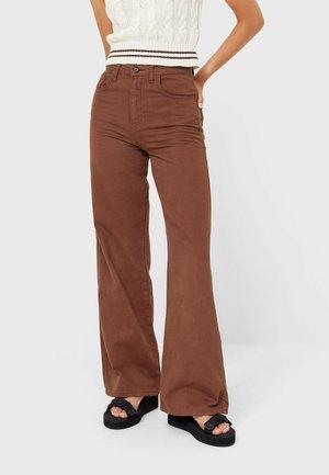 Flared Jeans - mottled dark brown