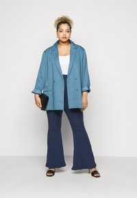 Glamorous Curve - FLARE TROUSERS - Trousers - teal - 1