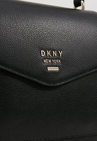 DKNY - WHITNEY SATCHEL  - Kabelka - black/gold - 6