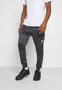 Nike Sportswear - Tracksuit bottoms - black/iron grey - 0