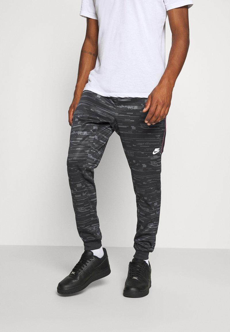 Nike Sportswear - Tracksuit bottoms - black/iron grey