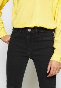 River Island Petite - PETITE MOLLY BAXTER - Slim fit jeans - black - 4
