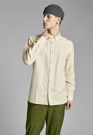 Camisa - brown rice