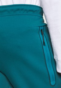 Nike Sportswear - TONE - Tracksuit bottoms - dark teal green/blustery - 4