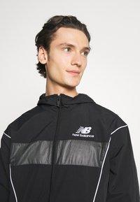New Balance - ATHLETICS WINDBREAKER - Summer jacket - black - 3