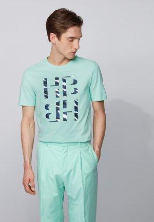 TESSLER - T-shirt print - open green