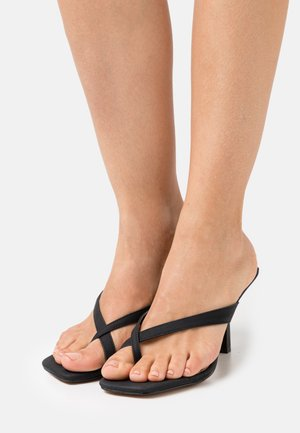 RILANNA - Heeled mules - black