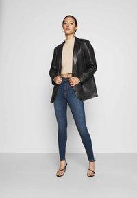 Vero Moda - VMSOPHIA SKINNY - Jeans Skinny Fit - dark blue denim - 1