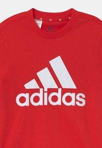 adidas Performance - UNISEX - Print T-shirt - vivid red/white - 2