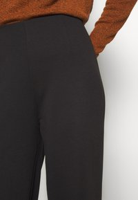 ONLY - ONLFEVER CLARA PANT - Pantalones - black - 4