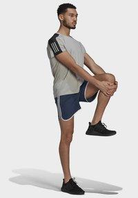 adidas Performance - MARATHON 20 SHORTS - Sports shorts - blue - 1