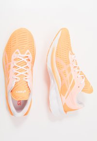 ASICS - NOVABLAST MODERN TOKYO - Neutral running shoes - orange pop/white - 1