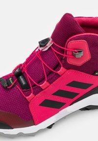 adidas Performance - TERREX MID GTX UNISEX - Hiking shoes - power berry/core black - 5