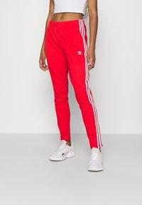 adidas Originals - PANTS - Joggebukse - red - 0