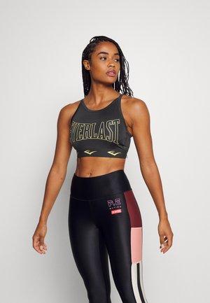 BRA DURAN - Brassières de sport à maintien léger - black/gold