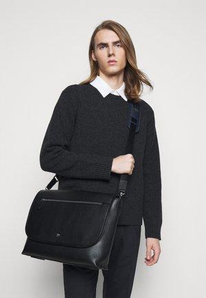 BRADHURST UNISEX - Across body bag - black
