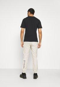 Columbia - SANTA ANA™ WINDPANT - Outdoor trousers - offwhite - 2
