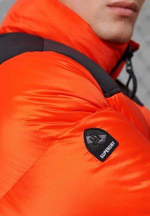 SPORTSTYLE CODE  - Gewatteerde jas - orange