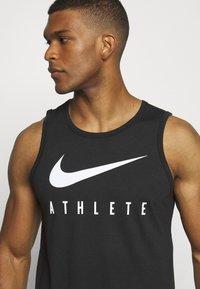 Nike Performance - TANK ATHLETE - Sports shirt - black/white - 4